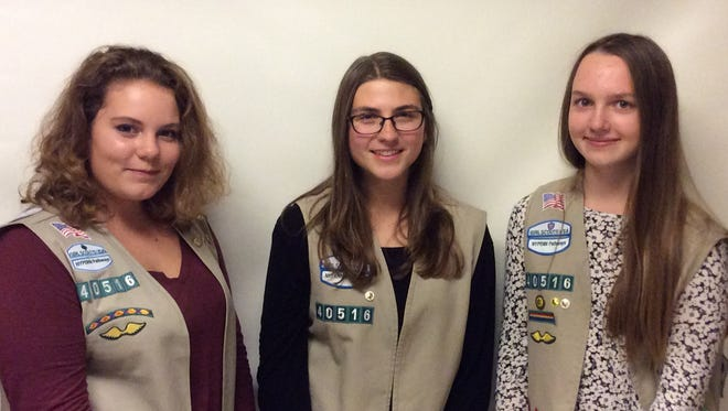 Girl Scout Cadettes Lily Bachner, Eryn Woernley and Laura Krebs earned their Silver Award, the highest award for Cadettes.
