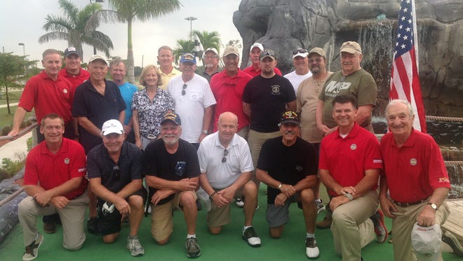Members of the PGA HOPE (Helping Our Patriots Everywhere) program celebrate graduation at Alico Family Golf in Fort Myers on Monday, April 17, 2017. This was the second edition of the program at Alico.