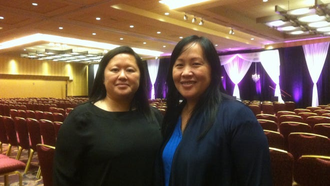 Hli Xyooj (left), co-chair of 18th Hmong National Development Conference, and Bao Vang, president and chief executive of Hmong National Development, are in Milwaukee to run the conference, which is to be attended by 1,000 people.