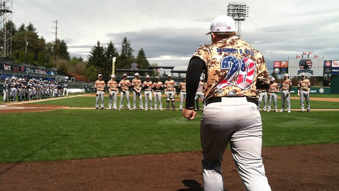 Central Kitsap High School baseball player Carson Wiler takes the field Saturday wearing the jersey of Seaman Apprentice Emmitt R. Wiler at the Tribute to Our Troops at Cheney Stadium in Tacoma. The event was hosted by the Elton Goodwin Memorial Foundation to honor military members. The invitational was a doubleheader featuring the Central Kitsap Cougars versus the Bellarmine Prep Lions and the South Kitsap Wolves versus the Gig Harbor Tides.
