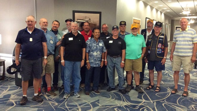 After not seeing one another for nearly 50 years, 14 crew members of the USS Baya (AGSS-318) reunited at Manitowoc's July 7-9 Subfest at Wisconsin Maritime Museum. Pictured, from left: Stan Hughes, Arizona; Wayne Hartlich, Wisconsin; Robin Onsoien, California; Tim Egenes, Nevada; Jim Marinello, Washington; Bob Mack, New Mexico; Danny Agahan, California; John McVay, Minnesota; Bruce Pickering, Wisconsin; Jim Mead, Arizona; Ken Groves, Washington; Dennis Hopkins, Connecticut; Dennis Dietrich, New York; and Jeff Bengston, Minnesota. Not pictured: Myron Bernt, Nebraska.