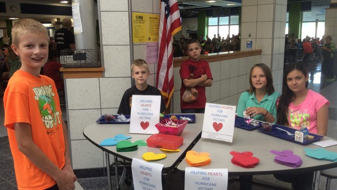 D.C. Everest Middle School Volunteens and Wolf PAC Club members sold paper hearts to support hurricane victims.