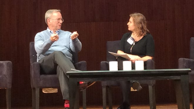 Former Google CEO Eric Schmidt makes a point Wednesday at an MIT conference on artificial intelligence and the future of work as Daniela Rus, director of MIT's Computer Science and Artificial Intelligence Laboratory, looks on.