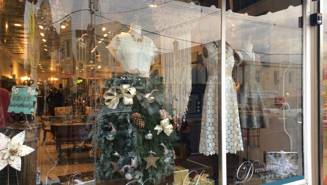 A view of the winning holiday window display from Dressed by Lori, the dress shop winning this year's holiday window decorating contest.