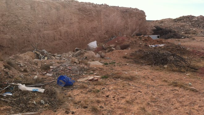 A caliche pit in Eddy County is full of garbage and debris ahead of being re-mediated.