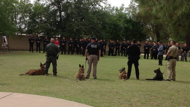 A group of officers gather at Our Saviour's Lutheran Church in Glendale on April 27, 2018, to celebrate the life of Bane, the fallen K-9 service dog.