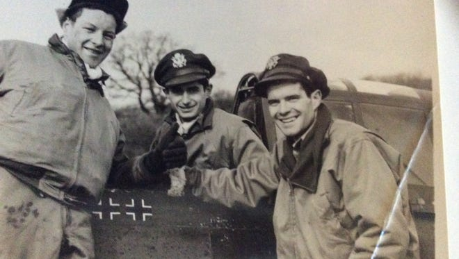 Frederick Joseph Christensen Jr., John Pope Bryant and Michael J. Quirk, pose in front of their aircraft during World War II