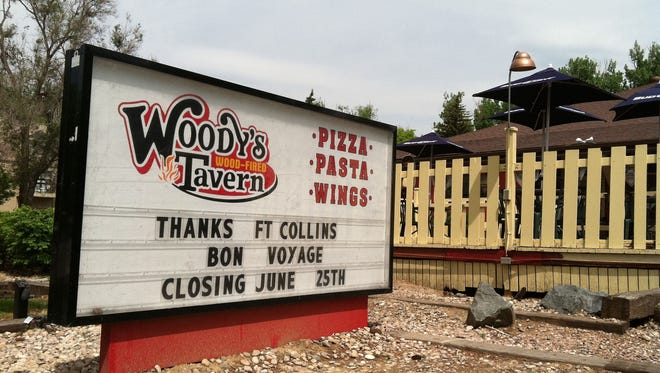 Woody's Woodfired Pizza closed to make way for a new student housing project.
