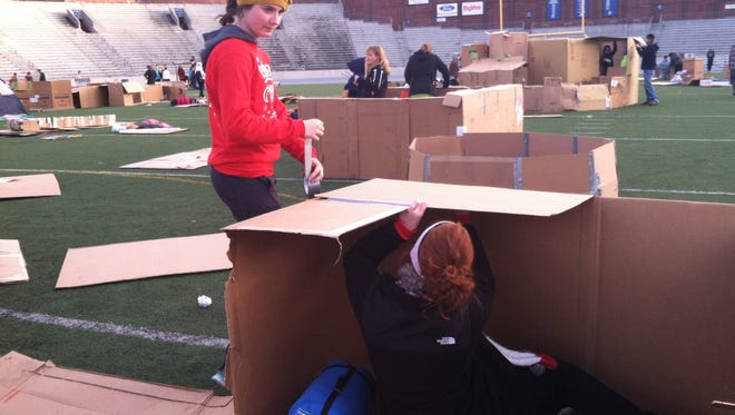 Waukee students build a shelter at Reggie's Sleepout Saturday.