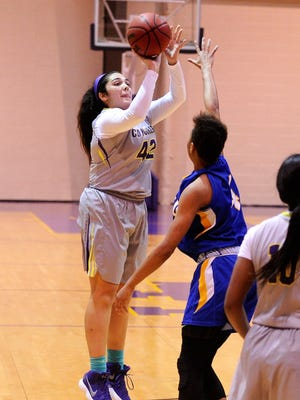 Hardin-Simmons center Addison Garcia takes a shot from the outside during Saturday's 76-65 win against LeTourneau. Garcia scored a team-high 20 points.