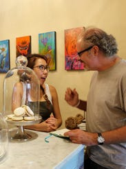 Aileen Amaya chats with customer Leon Dewan at R Patisserie