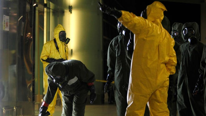 A hazmat crew scan the decontamination zone at Kuala Lumpur International Airport where North Korean ruler Kim Jong Un's half brother was killed by a dose of nerve agent.