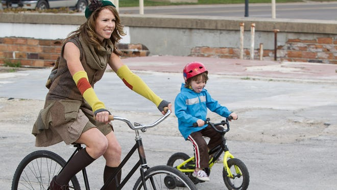 Event organizer Wanda Kennedy and her son Jenson, 4, of Iowa City ride to the Iowa City Bike Library for the start of the first annual Tweed Ride Saturday, April 7, 2012.