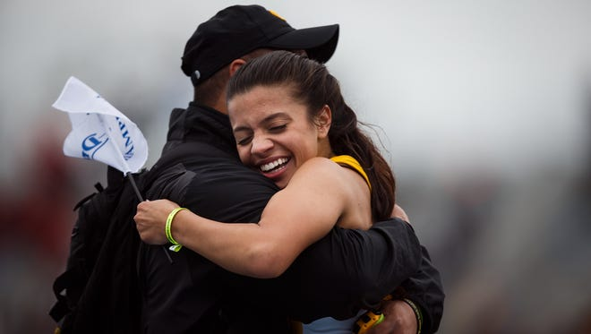 Iowa's Mahnee Watts celebrates with her coach after winning the women's 800 during the Drake Relays at Drake University on Friday, April 29, 2016 in Des Moines.