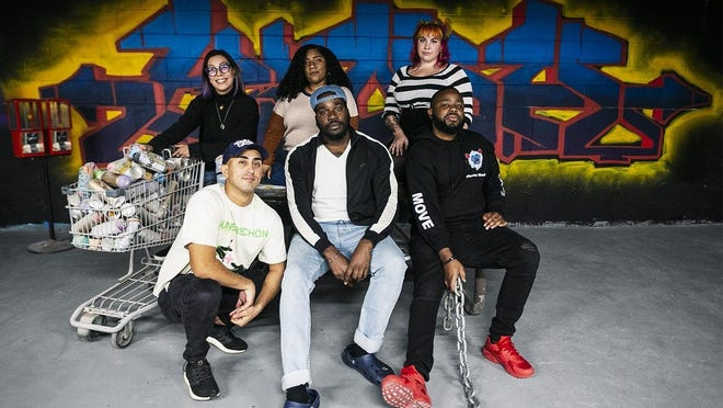 Brockton's Power of Art members (back row, from left) Lindsay Loza, Tricia Seda, Salena McAlarney (front row, from left) Roland Gilbert, Jamaal Bonnette and Barbatt Jocelyn pose for a portrait in the open studio space at Self Made Designs in Quincy on Thursday, Oct. 15, 2020. Self Made Designs will be printing the winning T-shirt designs from the TB12 competition.