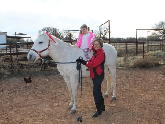Sadie Belle Compere, age 4, enjoys a bareback ride