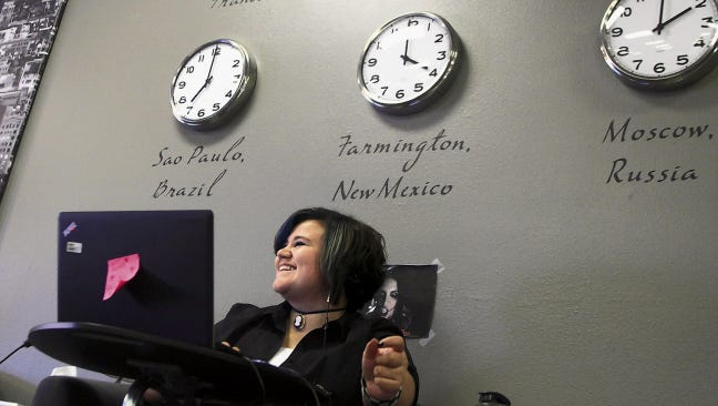 Student Monica Jackson talks with staff members while working on her English homework in August 2013 at the New Mexico Virtual Academy in Farmington.