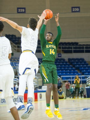 Rayville's JaMarkus Wilson (14) shoots over Madison's Kobe Julien (24) during the LHSAA Class 2A Boys Championship game on Saturday, March 11th, at Burton Coliseum in Lake Charles, La. (Roddy Johnson/American Press)
