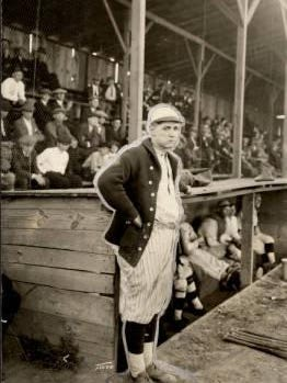 O'neal Hobbs stands near the dugout as manager. {Courtesy photo/Pueblo baseball history]