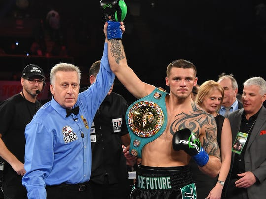 Joe Smith Jr. has his arm raised after defeating Bernard Hopkins.