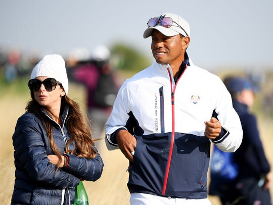 Tiger Woods and his girlfriend Erica Herman look on during the Presidents Cup in 2017.