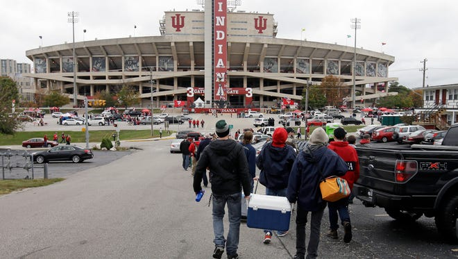 Fans walk to Memorial Stadium for an NCAA college football game between Indiana and Ohio State, Saturday, Oct. 3, 2015 in Bloomington, Ind. (AP Photo/Darron Cummings)