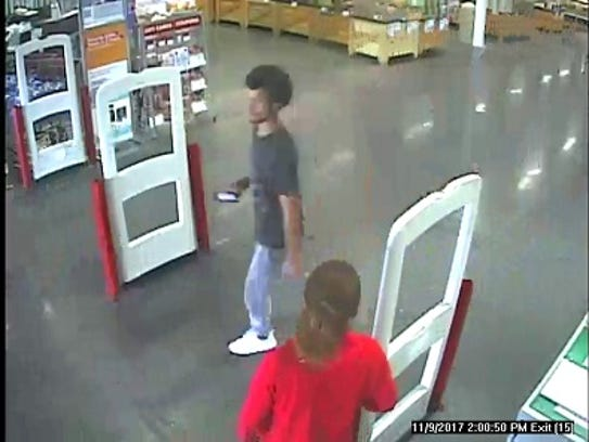 Police are trying to identify one of two men who walked out of BJ's Wholesale Club in Fort Myers with two television sets.