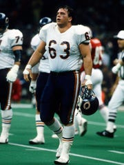 Former Iowa offensive lineman Jay Hilgenberg is shown during the 1986 Super Bowl while he was a key starter for the Chicago Bears.
