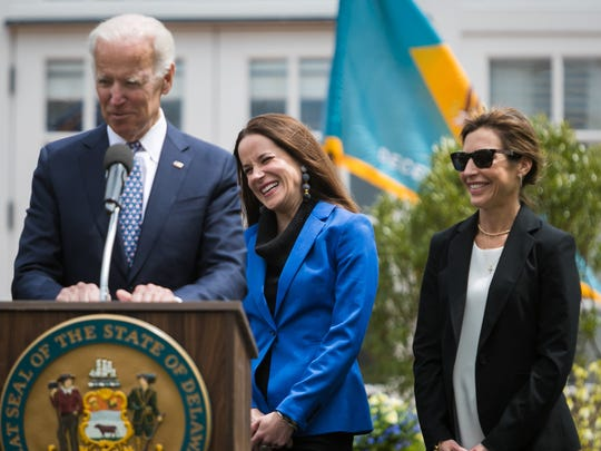 Former Vice President Joe Biden, Ashley Biden (center) and Hallie Biden attend last year's signing of the Beau Biden Gun Violence Prevention Act.