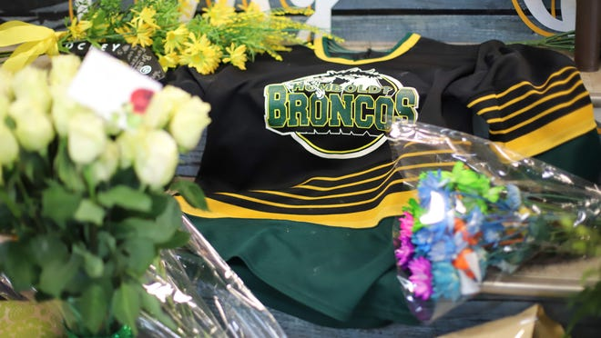 (FILES) In this file photo taken on April 8, 2018 An ice hockey jersey is left in a makeshift memorial at the Humboldt Uniplex in Humboldt, Saskatchewan, Canada.