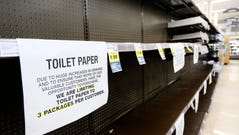 Shelves are picked bare of toilet paper at a grocery store in Burbank, Calif., on Saturday.