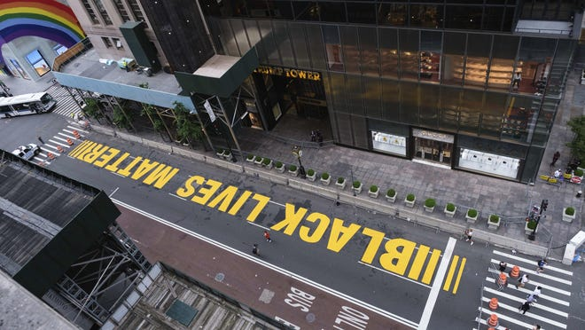 Pedestrians walk on a Black Lives Matter mural painted in front of Trump Tower in New York. Our language shields anti-Black white supremacy, rather than hold it accountable, Charles Blow writes.