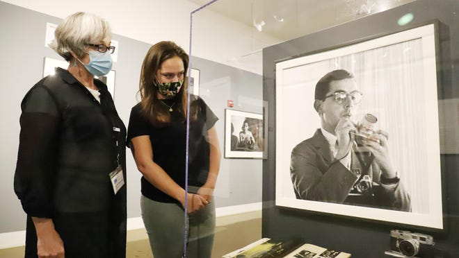 Julie Moncrief, Fort Smith Regional Art Museum development director, left, and Ellen Moncrieffe, read about photographer Jerry Dantzic in the exhibition Billie Holiday at Sugar Hill: Photographs by Jerry Dantzic, Saturday, Oct. 3, now open through December. The exhibition includes 40 large-scale photographs taken in 1957 of the iconic jazz singer, Billie Holiday. The RAM is conducting  campaign during October that asks for people to share how #ArtsCreateHope and to also help the RAM raise funds for an upgrade to its humidification system needed to protect the museum's art.