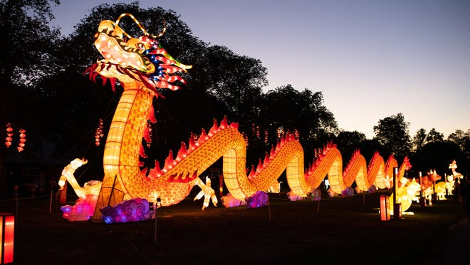 """Franklin Park Zoo's 197-foot-long dragon lantern is flanked by the Chinese zodiac signs, each with its own lantern display, during """"Boston Lights: A Lantern Experience"""" on Aug. 20."""