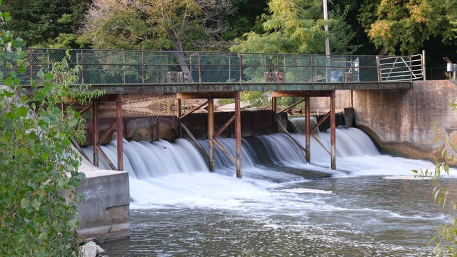 Water flows through the Standish Dam, which the city will need to rehabilitate. The Tecumseh City Council held a study session Monday to hear a proposal for evaluation and design of the rehabilitation project.