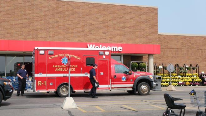 Emergency personnel are pictured at the scene of a fatal stabbing Wednesday at Meijer in Adrian.