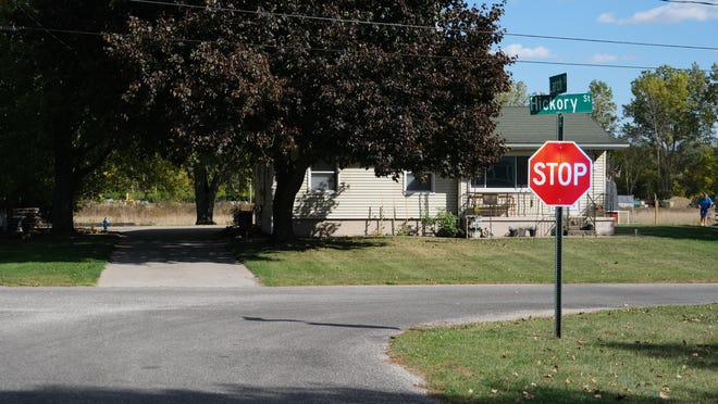 A new stop sign at the intersection of Larch and Hickory streets -- one of five new stop signs in the Willow Grove Court subdivision in Madison Township -- is pictured Thursday. The subdvision was built at a time when stop signs were not required. Township officials asked the Lenawee County Road Commission to install the stop signs after receiving speeding complaints.
