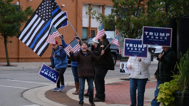 Trump supporters rally in downtown Hudson on Friday, the day President Donald Trump and First Lady Melania Trump were diagnosed with COVID-19.