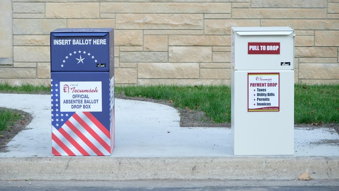 Two drop boxes, one for only absentee ballots and the other for other city business, placed on the curb near the parking lot exit of Tecumseh city hall last week.
