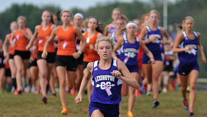 Lexington's Dominique Clairmonte leads the pack at the start of the girls race during the Lexington Cross Country Invite.