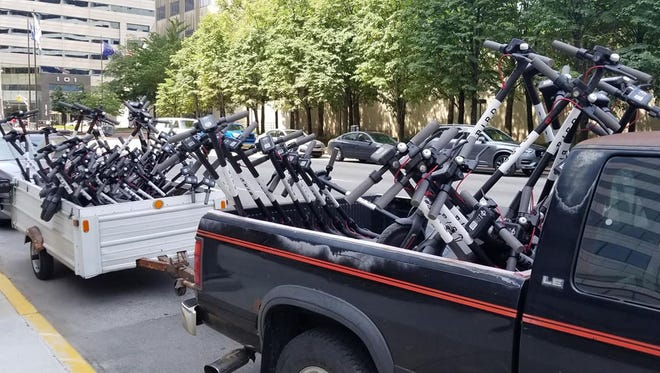 Bird scooters being collected on July 12, 2018, in Indianapolis. Keith Parker, the charger hired to assist in the removal efforts, said he collected 72 scooters on Thursday.