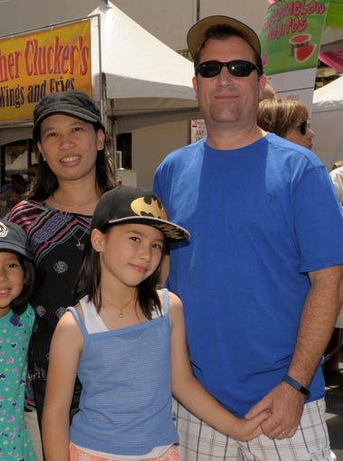 Maddie, 8, left, Jennie, Jikea, 9, and Mike Robin attend the Biggest Little City Wing Fest in downtown Reno on Saturday, July 1, 2017.   (Special to the RGJ/Lisa J. Tolda).