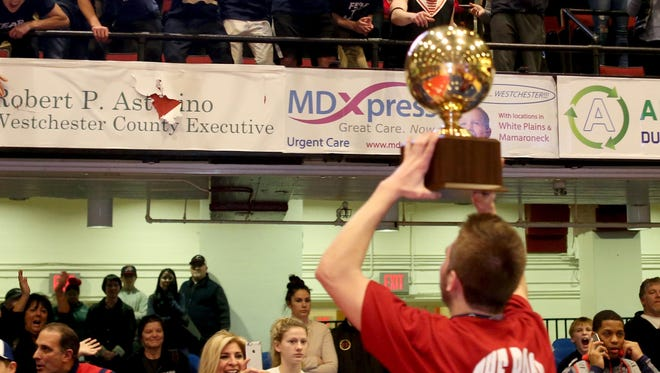 Byram Hills' Liam Nowlin celebrates his team winning a gold ball after last year's Class A championship at the County Center. Byram Hills enters this season as the No. 1 seed in the Class A tournament.
