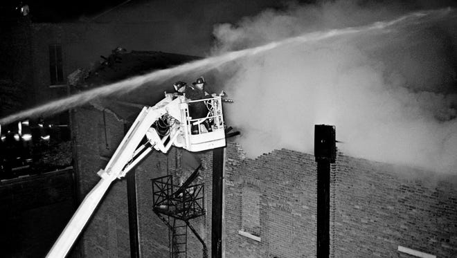 Metro firefighters are battling an out-of-control fire of the 80-year-old Loew's Vendome Theater at 615 Church Street during the early morning hours of 2 a.m. to 5 a.m. Aug. 9, 1967.