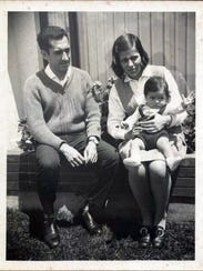 Jorge, a young child, is pictured with his parents.