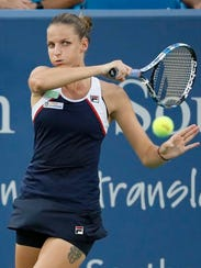 Karolina Pliskova, of the Czech Republic, returns to