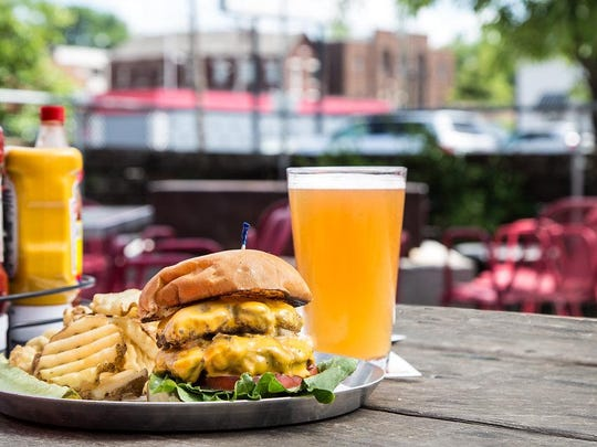 A burger on the patio at M.L. Rose.