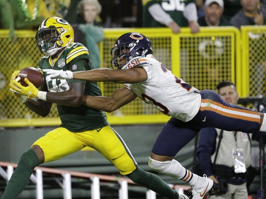 Green Bay Packers' Geronimo Allison catches a touchdown pass in front of Chicago Bears' Kyle Fuller during the second half of an NFL football game Sunday, Sept. 9, 2018, in Green Bay, Wis. (AP Photo/Jeffrey Phelps)
