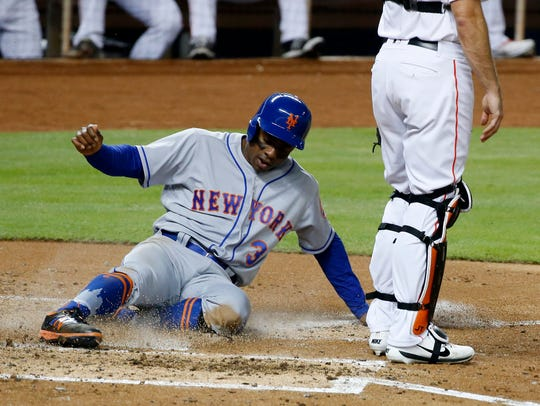 New York Mets' Curtis Granderson (3) scores on a double