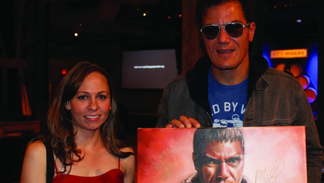 Greencastle resident Nicole Troup poses with actor Michael Shannon as he holds the portrait she created of him at the Angels of East Africa Gala in New York City on Nov. 4.